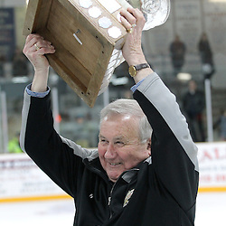 TRENTON, ON - Apr 22, 2016 -  Ontario Junior Hockey League game action between Trenton Golden Hawks and the Georgetown Raiders. Game 5 of the Buckland Cup Championship Series  at the Duncan Memorial Gardens in Trenton, Ontario. Trenton Golden Hawks John McDonald hoists the Buckland Cup.<br /> (Photo by Tim Bates / OJHL Images)