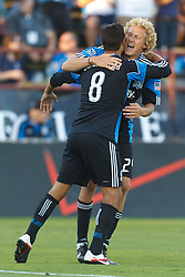 July 20, 2011; Santa Clara, CA, USA;  San Jose Earthquakes forward Chris Wondolowski (8) is congratulated by forward Steven Lenhart (24) after scoring a goal against the Vancouver Whitecaps during the first half at Buck Shaw Stadium.