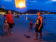 26 DECEMBER 2014 - PATONG, PHUKET, THAILAND: Tourists launch lanterns during memorial services for the victims of the 2004 tsunami on Patong Beach in Patong, Phuket. Hundreds of people died in Patong and nearly 5400 people died on Thailand's Andaman during the 2004 Indian Ocean Tsunami that was spawned by an undersea earthquake off the Indonesian coast on Dec 26, 2004. In Thailand, many of the dead were tourists from Europe. More than 250,000 people were killed throughout the region, from Thailand to Kenya. There are memorial services across the Thai Andaman coast this weekend.    PHOTO BY JACK KURTZ