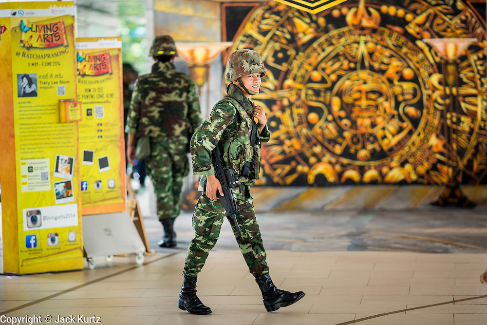 25 MAY 2014 - BANGKOK, THAILAND: Soldiers walk through the Bangkok BTS Skytrain system. Public opposition to the military coup in Thailand grew Sunday with thousands of protestors gathering at locations throughout Bangkok to call for a return of civilian rule and end to the military junta.     PHOTO BY JACK KURTZ