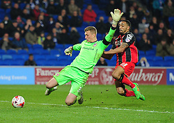 Goal keeper Cardiff City's Simon Moore manages  to clear the ball after making a mistake under pressure from Bournemouth's Callum Wilson - Photo mandatory by-line: Alex James/JMP - Mobile: 07966 386802 - 17/03/2015 - SPORT - Football - Cardiff - Cardiff City Stadium - Cardiff City v AFC Bournemouth - Sky Bet Championship