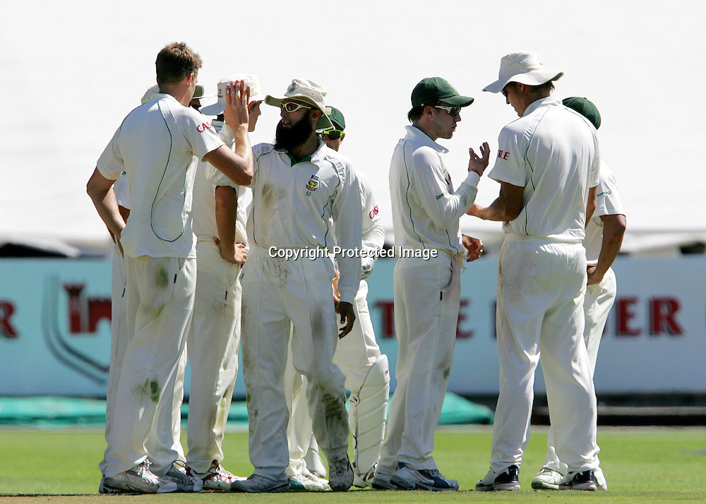 Hashim Amla and The Proteas congratulate Morne Morkel on the wicket of Alastair Cook during the 2nd day of the third test match between South Africa and England held at Newlands Cricket Ground in Cape Town on the 4th January 2010.Photo by: Ron Gaunt/ SPORTZPICS