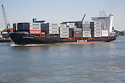 Heavily laden container ship 'BG Rotterdam'  on the River Maas, Port of Rotterdam, Netherlands