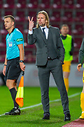 Heart of Midlothian caretaker manager Austin MacPhee signals a formation to his players during the Ladbrokes Scottish Premiership match between Heart of Midlothian FC and Livingston FC at Tynecastle Park, Edinburgh, Scotland on 4 December 2019.