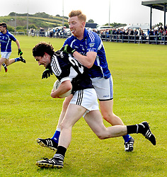 Kilmeena&rsquo;s Neilie Duffy tries to get past Killala&rsquo;s David Lawlor during the junior championship match on saturday evening last.<br />