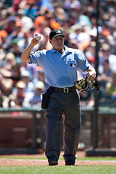 SAN FRANCISCO, CA - JUNE 29:  MLB umpire D.J. Reyburn #70 throws  a baseball during the sixth inning between the San Francisco Giants and the Cincinnati Reds at AT&T Park on June 29, 2014 in San Francisco, California.  The Cincinnati Reds defeated the San Francisco Giants 4-0.  (Photo by Jason O. Watson/Getty Images) *** Local Caption *** D.J. Reyburn