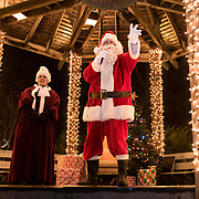 BRUNSWICK, Maine  11/24/18 -- Santa and Mrs. Claus light up the Christmas tree with Christmas magic -- with a countdown for all to help out - from the gazebo at the Brunswick downtown park at the tree lighting event on Saturday.  Photo by Roger S. Duncan for use by Brunswick Downtown Association