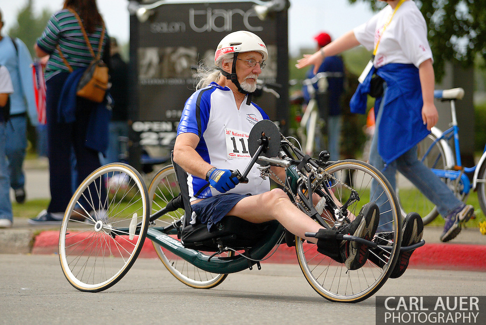July 4th, 2006:  Anchorage, Alaska - Thomas Knoppi (115), a Navy veteran from Renton, Washington, exits turn one in the 5k Handcycle race at the 26th National Veterans Wheelchair Games.