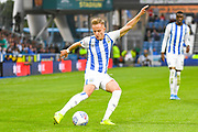 Florent Hadergjonaj of Huddersfield Town (33) in action during the EFL Sky Bet Championship match between Huddersfield Town and Derby County at the John Smiths Stadium, Huddersfield, England on 5 August 2019.
