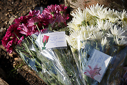 © licensed to London News Pictures. London, UK 01/03/2014. Mourners left flowers where two men, believed to be in their 20s, were found injured in a vehicle and later died in Leytonstone, east London on Saturday, 1 March 2014. Photo credit: Tolga Akmen/LNP