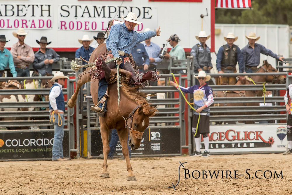 Saddle brond rider JD Anderson rides Summit Pro Rodeo's Honky Tonk during the third performance of the Elizabeth Stampede on Sunday, June 3, 2018.