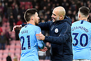 Manchester City manager Pep Guardiola goes to hug David Silva (21) of Manchester City at full time after a 1-0 win over Bournemouth during the Premier League match between Bournemouth and Manchester City at the Vitality Stadium, Bournemouth, England on 2 March 2019.
