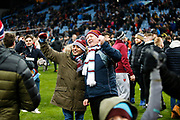 Aston Villa fans celebrates and invade the pitch after the EFL Cup Semi-Final match between Aston Villa and Leicester City at Villa Park, Birmingham, England on 28 January 2020.