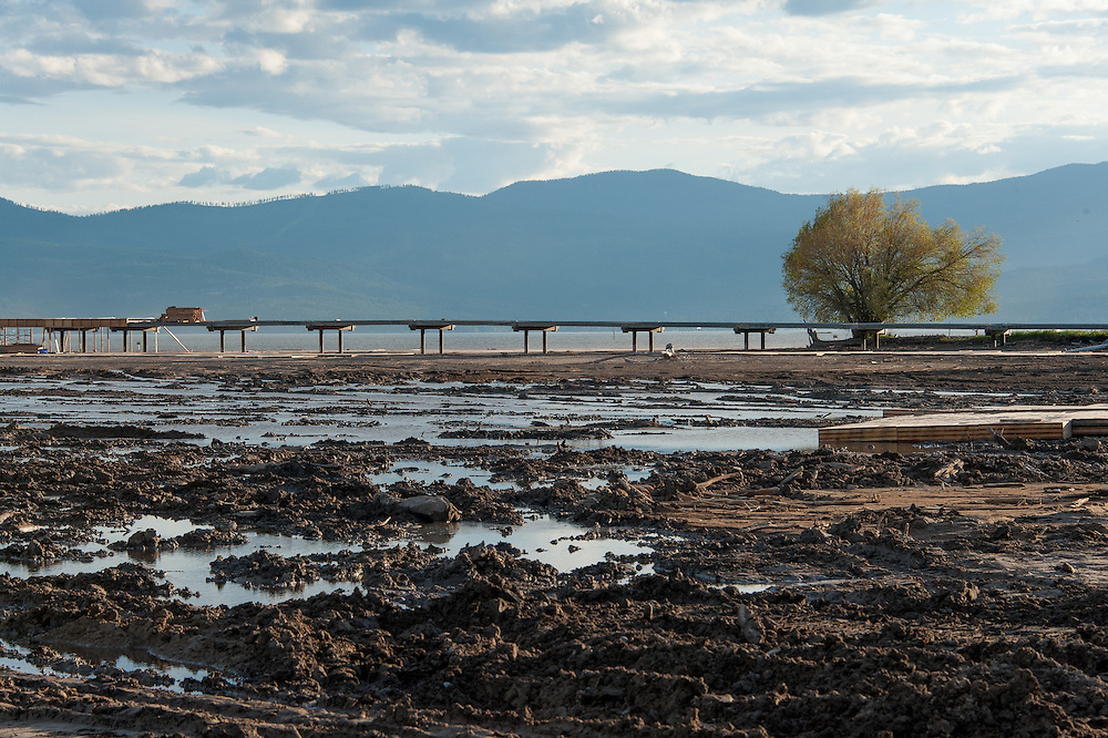 A westward looking view of the bridge under construction with the highly disturbed lakebed in the foreground.   Destruction of the lakebed and the resulting loss of scenic value to the area caused by construction of a private bridge to Dockstader Island on the north shore of Flathead Lake in Bigfork, Montana, in violation of the state's Lakeshore Protection Act, as photographed on May 20, 2015.