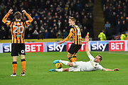 Leeds United player Laurens De Bock (12) brought down by Hull City midfielder Markus Henriksen (22)  during the EFL Sky Bet Championship match between Hull City and Leeds United at the KCOM Stadium, Kingston upon Hull, England on 30 January 2018. Photo by Ian Lyall.