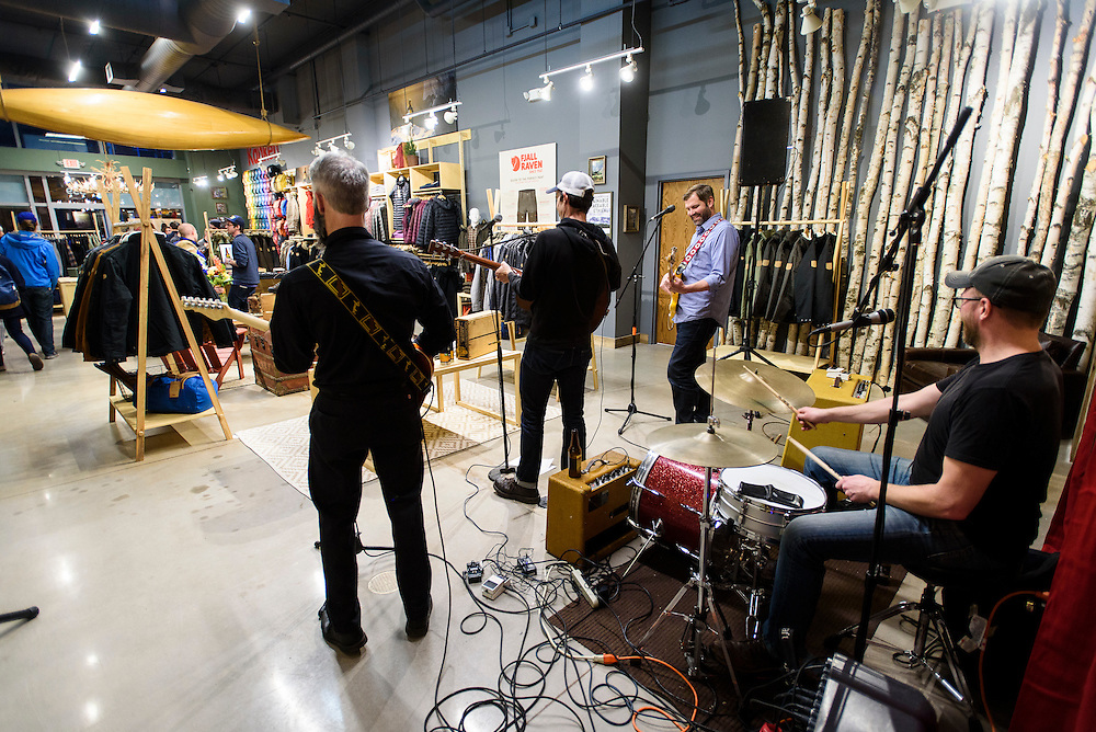 A band plays music as guests mingle and look at clothing apparel and outdoor-outfitter gear during a grand opening event for Fjällräven Madison, a Swedish-heritage brand store in downtown Madison, Wis., on Oct. 22, 2015. (Photo by Jeff Miller - www.jeffmillerphotography.com)