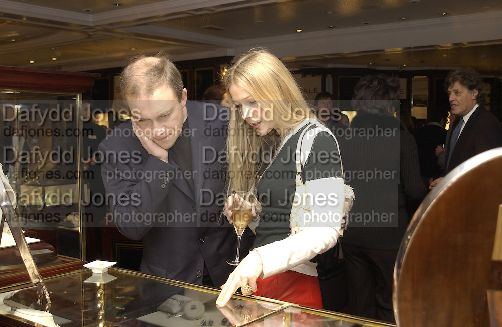 Mr. and Mrs. Harry Enfield. Charity sale of the last ever sale at Asprey and Garrard. New Bond St. London. 15/1/02© Copyright Photograph by Dafydd Jones 66 Stockwell Park Rd. London SW9 0DA Tel 020 7733 0108 www.dafjones.com