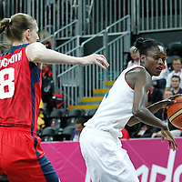 07 August 2012: France Emilie Gomis drives past Czech Republic Ilona Burgrova during 71-68 Team France victory over Team Czech Republic, during the women's basketball quarter-finals, at the Basketball Arena, in London, Great Britain.