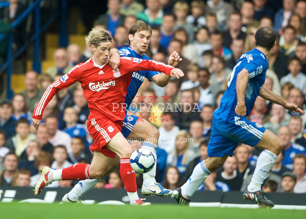 LONDON, ENGLAND - Sunday, October 4, 2009: Liverpool's Fernando Torres and Chelsea's Branislav Ivanovic during the Premiership match at Stamford Bridge. (Pic by David Rawcliffe/Propaganda)