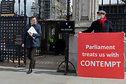 As Prime Minister Theresa May again meets opposition Labour leader Jreemy Corbyn in an attempt to break the deadlock in parliament of Brexit, a betrayed Brexiteer protestor stands outside the gates of parliament in Westminster, on 4th April 2019, in London, England.