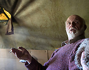 "Tara activist JP Fay in his hut at Tara. Fay, from Trim has been one of the long-term activists in fighting the M3 motorway's path through the Tara area. He and other proposed an alternative route that was turned down, and was one of the ""Tara Four"" jailed for refusing to bail conditions to stay away from the construction site..."