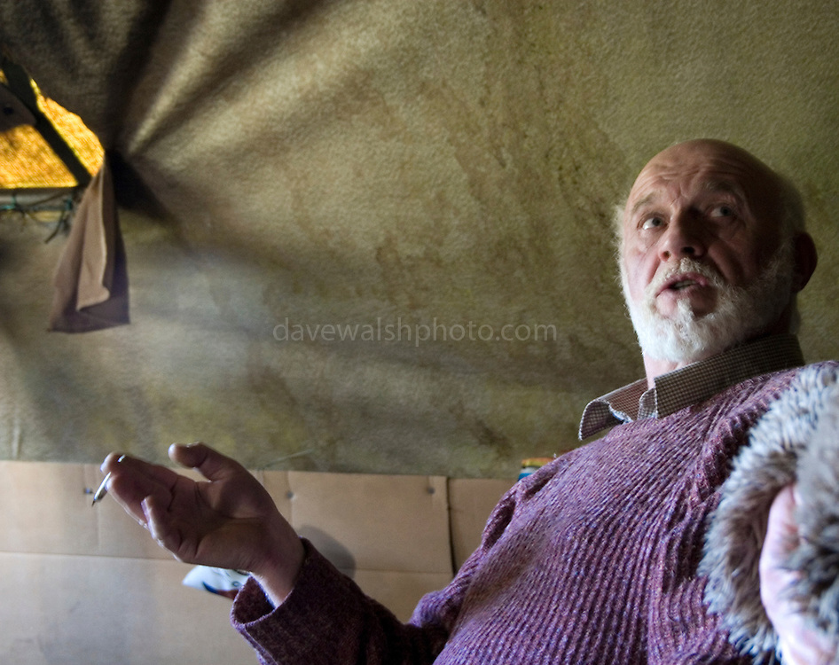 """Tara activist JP Fay in his hut at Tara. Fay, from Trim has been one of the long-term activists in fighting the M3 motorway's path through the Tara area. He and other proposed an alternative route that was turned down, and was one of the """"Tara Four"""" jailed for refusing to bail conditions to stay away from the construction site..."""