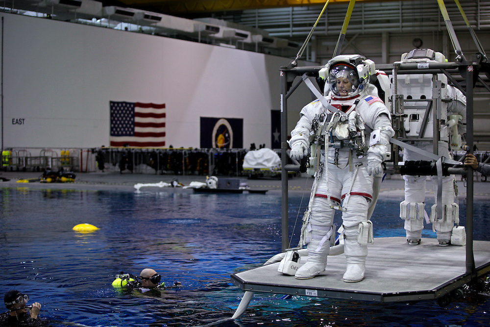 2009 Private tour of NASA neutral buoyancy lab at Johnson Space Center in Houston, Texas on Monday, August 31, 2009. Astronauts are trained for EVA (extra vehicular activities) or space walks in the pool is the largest pool in the world, it measures 200 ft by 120 ft by 40 ft deep.  Met astronauts Shayne Kimbrough, Dorothy Metcalf-Lindenburger and Commander Mike Mossimoso.  Dorothy is headed up on the space shuttle in March of 2010, which is one of the last shuttle missions.