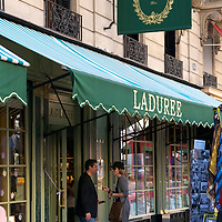 A couple in front of Laduree on Rue Royale.