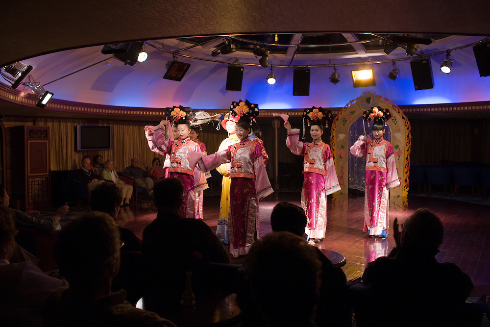Traditional dancers performing on Victoria Line Cruise Ship for Western tourists, Yangtze River, China