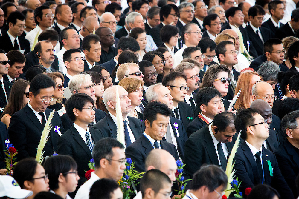 """HIROSHIMA, JAPAN - AUGUST 6 : Delegates of foreign diplomatic delegations pay respects during 71st anniversary of the atomic bombing on Hiroshima ceremony at Hiroshima Peace Memorial Park in Hiroshima, western Japan, Saturday, August 6, 2016. Japan marked the 71st anniversary of the atomic bombing on Hiroshima. On August 6, 1945, during World War II, the United States dropped a uranium gun-type atomic bomb named """"Little Boy"""" on the city of Hiroshima which instantly killed an estimated 80,000 people, tens of thousands more would later die of radiation exposure. Three days later, a second American B-29 bomber dropped a plutonium implosion-type bomb """"Fat Man"""" on Nagasaki, killing an estimated 40,000 people.  (Photo: Richard Atrero de Guzman/NURPhoto)"""