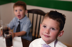 Two young boys at a wedding reception,