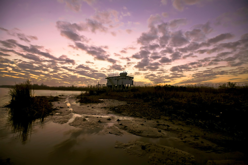 Abandoned station on river bank in Venice, LA.  Copyright 2011 Reid McNally.