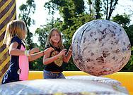 Katie McKerchar (left),  7 and her sister Emily MaKerchar, 10 play on the wrecking ball during the annual first Fourth event at Newtown Middle School Saturday July 11, 2015 in Newtown, Pennsylvania. The celebration was held a week late this year cause fireworks company couldn't make it on July 4th. (Photo by William Thomas Cain)