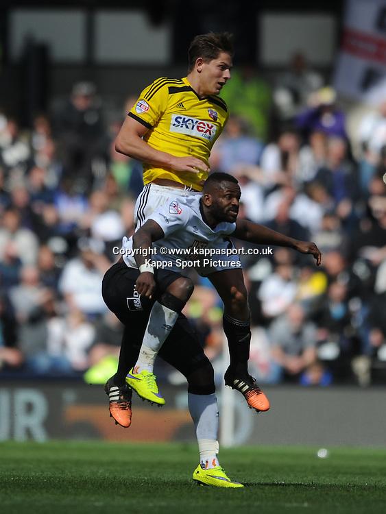 Brentford James Tarkowski holds of Derby Darren Bent, Derby County v Brentford, Sy Bet Championship, IPro Stadium, Saturday 11th April 2015. Score 1-1,  (Bent 92) (Pritchard 28)<br /> Att 30,050