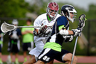 7 MAY 2009 -- CREVE COEUR, Mo. -- St. Louis University High School lacrosse player Andrew Schoessel (36) moves past DeSmet Jesuit High School's Steve Savio (12) during second half of the 7th annual Father Marco Cup at DeSmet in Creve Coeur, Mo. Saturday, May 7, 2011. SLUH topped DeSmet 13-10 in the annual game. Image © copyright 2011 Sid Hastings.