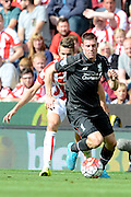 James Milner on the ball during the Barclays Premier League match between Stoke City and Liverpool at the Britannia Stadium, Stoke-on-Trent, England on 9 August 2015. Photo by Alan Franklin.