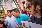 25 JUNE 2012 - PHOENIX, AZ:   Protesters chant in front of the Immigration and Customs Enforcement (ICE) offices in central Phoenix Monday. About 100 immigration supporters held a protest against ICE and continued deportations by the Obama administration. Protesters also celebrated the US Supreme Court decision to overturn most of SB1070, Arizona's tough anti-immigration law.     PHOTO BY JACK KURTZ