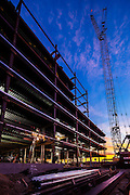 welding steel girders at sunrise on a commercial building