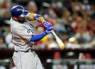 Sep. 27 2011; Phoenix, AZ, USA; Los Angeles Dodgers outfielder Matt Kemp (27) doubles to center during the fourth inning against the Arizona Diamondbacks at Chase Field.  Mandatory Credit: Jennifer Stewart-US PRESSWIRE.