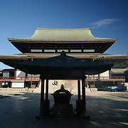The Great Main Hall and courtyard. In the center of frame are incense sticks burning, with smoke rising. The Narita-san temple, also known as Shinsho-Ji (New Victory Temple), is Shingon Buddhist temple complex, was first established 940 in the Japanese city of Narita, east of Tokyo.