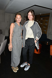 Left to right, ERIN MULLANEY and ROMILLY MASON at a dinner to celebrate London Fashion Week SS 2015 and the opening of Ramusake at 92 Old Brompton Road, London on 15th September 2014.