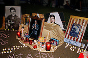 Police say about 30,000 fans participated in the Candlelight Vigil at Elvis Presley's Memphis home, Graceland, according to Graceland officials. Fans lit candles, created shrines and sang Elvis songs before the gates opened. A ceremony began about 8:30 outside of the Graceland gates and many fans processed passed the grave of the King of Rock and Roll.