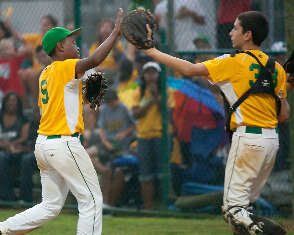 Erial's Jake Vespa and Adam Holland celebrate after Holland stuck a runner out for the final out in the 5th inning during a Section 4 Little League final against Cherry Hill held in Gloucester Sunday night.