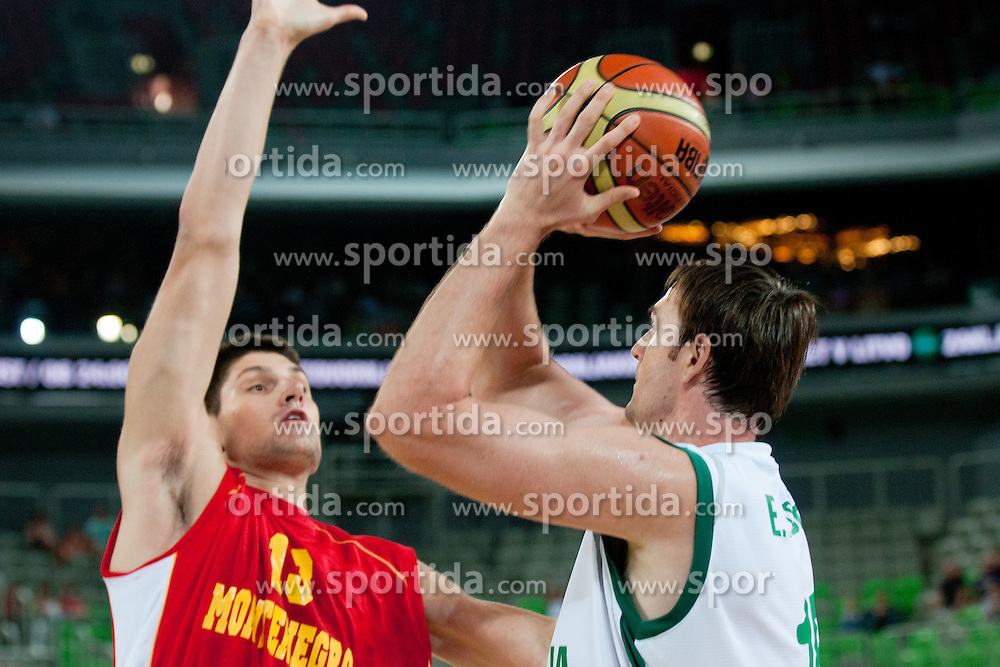 Erazem Lorbek of Slovenia vs Nikola Vucevic of Montenegro at friendly match between Slovenia and Montenegro for Adecco Cup 2011 as part of exhibition games before European Championship Lithuania on August 7, 2011, in SRC Stozice, Ljubljana, Slovenia. (Photo by Matic Klansek Velej / Sportida)