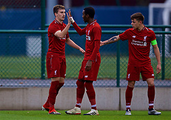 SAINT-GERMAIN-EN-LAYE, FRANCE - Wednesday, November 28, 2018: Liverpool's Liam Millar (L) celebrates scoring the first goal with team-mates Rafael Camacho (C) and captain Adam Lewis (R) during the UEFA Youth League Group C match between Paris Saint-Germain Under-19's and Liverpool FC Under-19's at Stade Georges-Lefèvre. (Pic by David Rawcliffe/Propaganda)