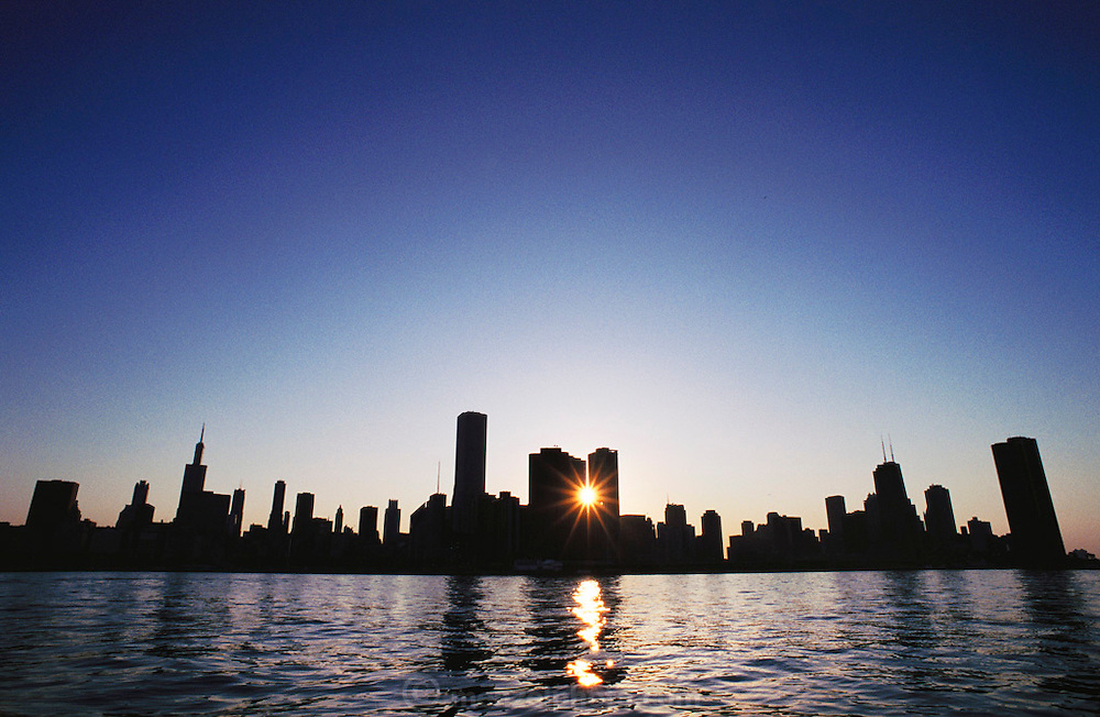 Chicago skyline at sunset, seen from Lake Michigan, Illinois, USA.