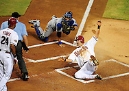 Jul. 15 2011; Phoenix, AZ, USA; Los Angeles Dodgers catcher Dioner Navarro (30) tags Arizona Diamondbacks baserunner Willie Bloomquist (18) out at home plate during the first inning at Chase Field. Mandatory Credit: Jennifer Stewart-US PRESSWIRE.
