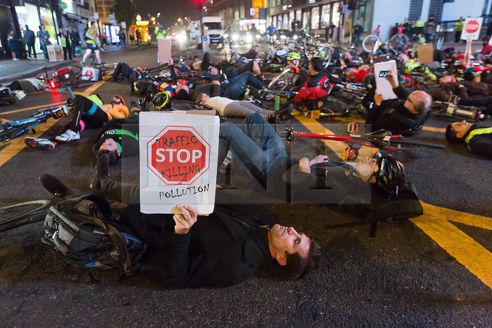 © Licensed to London News Pictures. 31/10/2016. LONDON, UK.  Campaign group, 'Stop Killing Cyclists' hold a die in protest in the road at Lavender Hill in south London at the spot where cyclist, Lucia Ciccioli was killed following a collision with a Heavy Goods Vehicle (HGV) lorry one week ago. Cycling groups and their supporters are campaigning and calling for the Mayor of London, Sadiq Khan to ban HGV's from the capital.  Photo credit: Vickie Flores/LNP