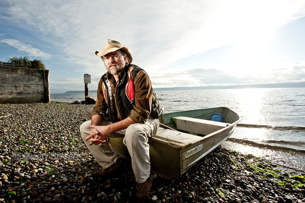 Jack Archibald, near his home on Camano Island, with his boat.