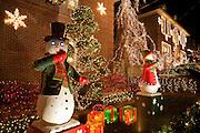 Mechanical snowmen with eerie glowing eyes in Dyker Heights.